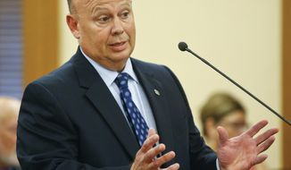 Corrections Secretary Joe Norwood answers a question from a lawmaker during a hearing with the legislative committee as they discussed the Lansing Correction Facility, in Topeka, Kan., Thursday, Aug. 3, 2017. (Chris Neal/The Topeka Capital-Journal via AP)