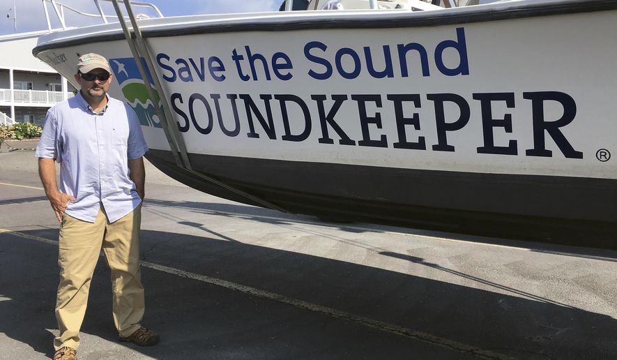 "In this Thursday, Aug. 3, 2017 photo provided by Save the Sound, William Lucey stands beside the vessel ""Soundkeeper"" at Brewers Marina in Stratford, Conn. The 48-year-old was officially introduced Thursday, Aug. 3, 2017, as the new public watchdog of the 1,300-square-mile estuary that stretches from New York City to eastern Connecticut. He replaces soundkeeper Terry Backer, who died in 2015. (Tracy Brown/Save the Sound via AP)"