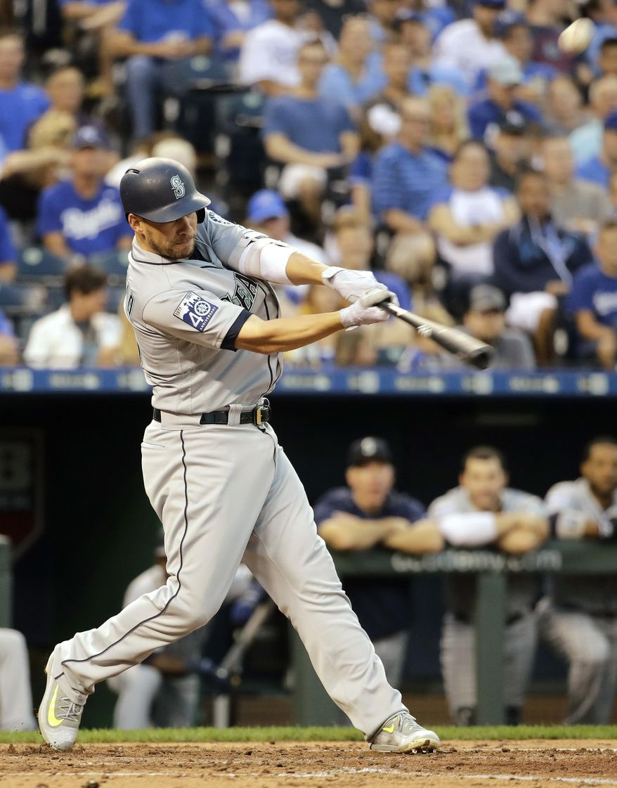 Seattle Mariners' Danny Valencia hits a solo home run during the fourth inning of a baseball game against the Kansas City Royals Thursday, Aug. 3, 2017, in Kansas City, Mo. (AP Photo/Charlie Riedel)