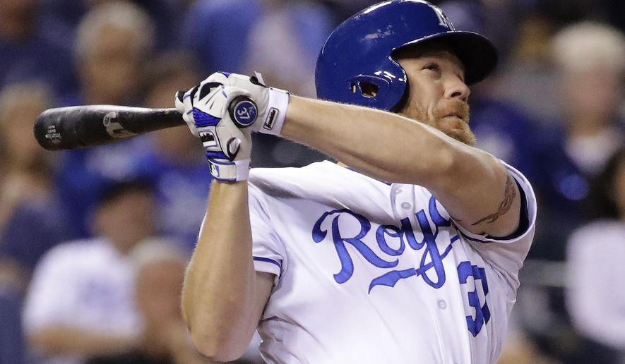 Kansas City Royals' Brandon Moss hits a two-run home run during the fifth inning of a baseball game against the Seattle Mariners Thursday, Aug. 3, 2017, in Kansas City, Mo. (AP Photo/Charlie Riedel)
