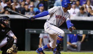 New York Mets' Curtis Granderson watches his three-run home run against the New York Mets during the sixth inning of a baseball game Wednesday, Aug. 2, 2017, in Denver. (AP Photo/Jack Dempsey)