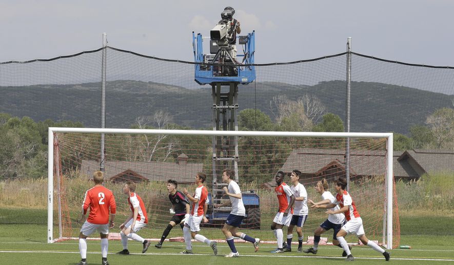 In this July 11, 2017, photo, a camera filming play during a MLS video replay scrimmage organized in a community park, in Park City, Utah. The games were staged as part of the final training camp to gauge referees' competence in and comfort with video replay. (AP Photo/Rick Bowmer)