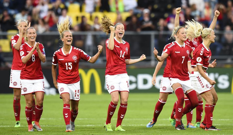 Denmark's players celebrate during the penalty shoot-out at the Women's Euro 2017 semifinal soccer match between Denmark and Austria in Breda, the Netherlands Thursday, Aug. 3, 2017. (AP Photo/Ermindo Armino)
