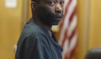 Raymond Durham appears in court in Detroit on Thursday, Aug. 3, 2017. Authorities charged Durham with first-degree murder Thursday in the slaying of Wayne State University police officer Collin Rose near campus, the third officer he is accused of shooting in Detroit. (Daniel Mears/Detroit News via AP)