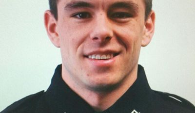 FILE - This undated file photo provided by Wayne State University shows university police officer Collin Rose, who died after being shot in the head while on patrol near a university campus in Detroit on Nov. 22, 2016. Authorities on Thursday, Aug. 3, 2017, charged Raymond Durham with first-degree murder in Rose's death. (Wayne State University via AP, File)