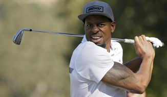 FILE - In this Oct. 12, 2016, file photo, Golden State Warriors' Andre Iguodala follows his shot from the 16th fairway of the Silverado Resort North Course during the pro-am event of the Safeway Open PGA golf tournament, in Napa, Calif. Iguodala's second passion is golf. He's putting that to work at the PGA Championship by doing reporting for Turner Sports. (AP Photo/Eric Risberg, File)