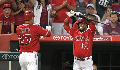 Los Angeles Angels' Mike Trout, left, is congratulated by Luis Valbuena after hitting a two-run home run during the third inning of the team's baseball game against the Philadelphia Phillies, Wednesday, Aug. 2, 2017, in Anaheim, Calif. (AP Photo/Mark J. Terrill)