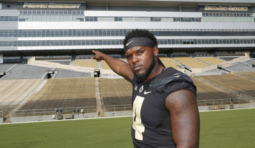 Purdue NCAA college football linebacker Ja'Whaun Bentley strikes a pose during Purdue University football media day in West Lafayette, Ind., Thursday, Aug. 3, 2017.   (John Terhune/Journal & Courier via AP)