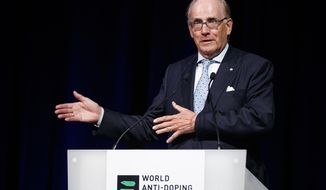 """FILE - This is a Monday March 13, 2017 file photo of lawyer Richard McLaren, investigator and report author for the world anti-doping agency , WADA, as he delivers his speech addressing his findings on Russian State-Sponsored doping systems during the opening day of the 2017 world anti-doping agency annual symposium, at the Swiss Tech Convention Center, in Lausanne, Switzerland.  The World Anti-Doping Agency says the Russian government must accept the findings of a report which accused it of overseeing widespread doping and a cover-up. Last year's report by WADA investigator Richard McLaren said Russian Sports Ministry officials decided which athletes to """"save"""" by covering up failed drug tests, and swapped samples containing banned substances at the 2014 Winter Olympics (Valentin Flauraud/Keystone, File via AP)"""