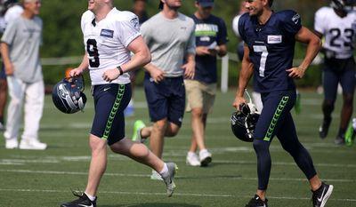 Seattle Seahawks punter Jon Ryan (9) and kicker Blair Walsh (7) take to the field for NFL football training camp, Thursday, Aug. 3, 2017, in Renton, Wash. (Ken Lambert/The Seattle Times via AP)