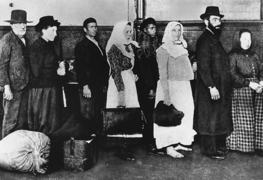 "In this undated photo of a group of immigrants, who arrived at Ellis Island in New York, wait in line to begin immigration proceedings. Senior White House aide Stephen Miller told reporters Wednesday, Aug. 2, 2017, that the poem written by Emma Lazarus about the ""huddled masses"" is not part of the original Statue of Liberty. Miller says the Statue of Liberty is a ""symbol of American liberty lighting the world"" and suggested the statue had little to do with immigrants. The National Park Services says Lazarus' sonnet depicts the statue as a symbol of immigration and opportunity. (AP Photo/File)"