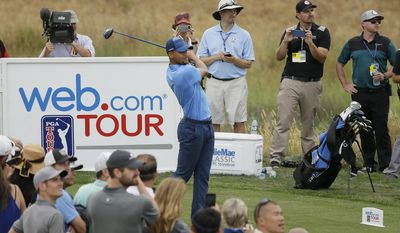 Golden State Warriors NBA basketball player Stephen Curry follows his drive from the ninth tee during the Web.com Tour's Ellie Mae Classic golf tournament Thursday, Aug. 3, 2017, in Hayward, Calif. Curry shot a 4-over-par 74. (AP Photo/Eric Risberg)