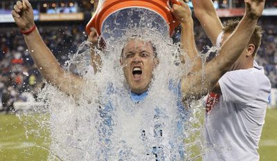 FILE - In this Aug. 28, 2014, file photo, former Tennessee Titans linebacker Tim Shaw is doused as he takes the ALS Ice Bucket Challenge during a preseason NFL football game between the Titans and the Minnesota Vikings in Nashville, Tenn. To the Tennessee Titans, Tim Shaw is a teammate for life, and the former special teams captain even has his own locker even as he battles ALS, amyotrophic lateral sclerosis better known as Lou Gehrig's disease. (AP Photo/Mark Zaleski, File)