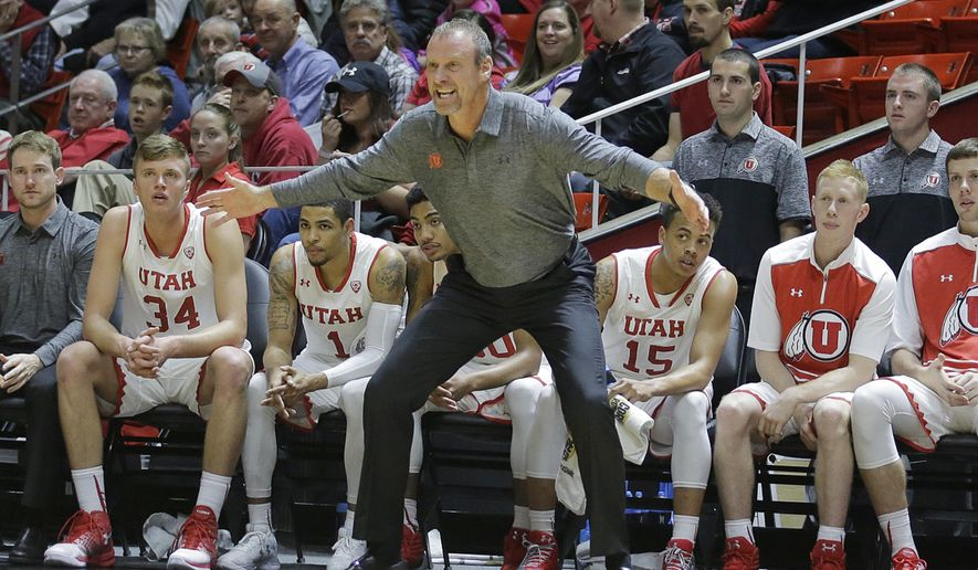 FILE - In this Jan. 1, 2017, file photo, Utah coach Larry Krystkowiak shouts to his team during the first half of an NCAA college basketball game against Colorado, in Salt Lake City. The Utah men's basketball team is heading to Europe for a 10-day tour. They'll play three games during the trip for an experience that is becoming common for collegiate teams.(AP Photo/Rick Bowmer, File)