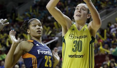 FILE - In this July 12, 2017, file photo, Seattle Storm's Breanna Stewart (30) shoots as Connecticut Sun's Alyssa Thomas backs away in the first half of a WNBA basketball game, in Seattle. Breanna Stewart can now compete against other WNBA players in a video game. Her teammates will be featured in a video game for the first time this fall. (AP Photo/Elaine Thompson, File)