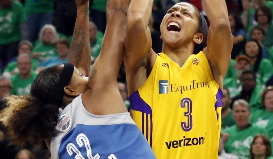FILE - In this Oct. 20, 2016, file photo, Los Angeles Sparks' Candace Parker, right, attempts to shoot over Minnesota Lynx's Rebekkah Brunson in the first quarter during Game 5 of the WNBA basketball finals. The developers held motion capture sessions with WNBA players, including veteran Candace Parker, to be featured in a video game for the first time this fall.  (AP Photo/Jim Mone, File)