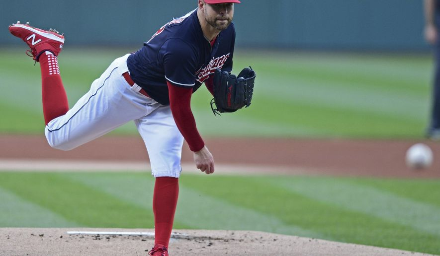 Cleveland Indians starting pitcher Corey Kluber delivers in the first inning of a baseball game against the New York Yankees, Thursday, Aug. 3, 2017, in Cleveland. (AP Photo/David Dermer)