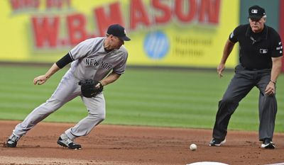 New York Yankees' Chase Headley chases after a ball hit by Cleveland Indians' Bradley Zimmer in the first inning of a baseball game, Thursday, Aug. 3, 2017, in Cleveland. Zimmer was safe at first. Headley was given an error. (AP Photo/David Dermer)