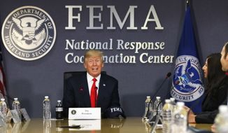 President Donald Trump meets with emergency officials to discuss the hurricane season, Friday, Aug. 4, 2017, at Federal Emergency Management Agency (FEMA) headquarters in Washington. At right is interim Homeland Security Secretary Elaine Duke. (AP Photo/Jacquelyn Martin)