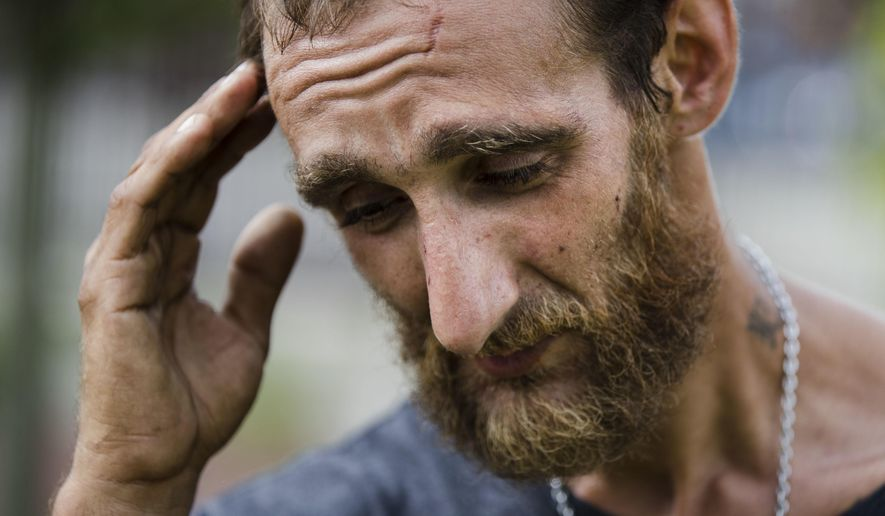 In this Monday, July 24, 2017 photo, Steven Kemp, who is addicted to heroin and is homeless, speaks with The Associated Press after meeting with a Philly Restart representative for help to obtain an identification card in Philadelphia. As an opioid epidemic ravages the nation, small but vulnerable populations of homeless people who are seeking respite from their addictions are sometimes turned away from the country's already threadbare system of drug treatment centers because they do not have valid photo identification (AP Photo/Matt Rourke)