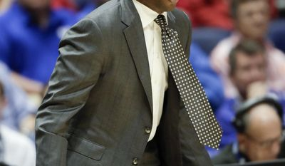 FILE - In this March 10, 2017, file photo, Alabama head coach Avery Johnson yells to his players during the first half of an NCAA college basketball game against South Carolina at the Southeastern Conference tournament, in Nashville, Tenn. Alabama basketball coach Avery Johnson has received a two-year contract extension through 2023. The board of trustees' compensation committee approved the extension on Friday, Aug. 4, 2017. Johnson will receive $2.9 million annually under the six-year deal.(AP Photo/Wade Payne, File)