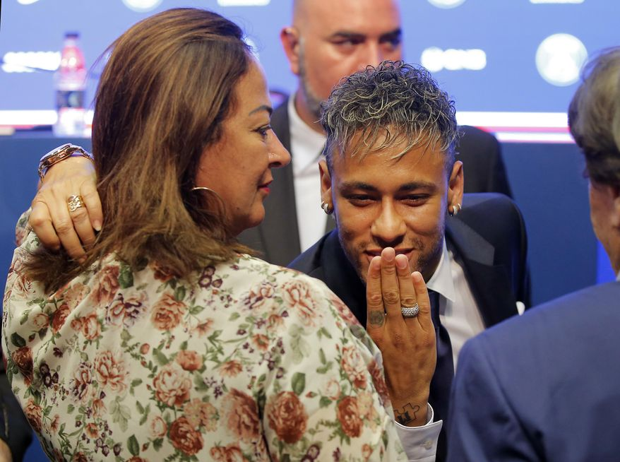 Brazilian soccer star Neymar blows a kiss during a press conference in Paris Friday, Aug. 4, 2017. Neymar arrived in Paris on Friday the day after he became the most expensive player in soccer history when completing his blockbuster transfer to Paris Saint-Germain from Barcelona for 222 million euros ($262 million).(AP Photo/Michel Euler)