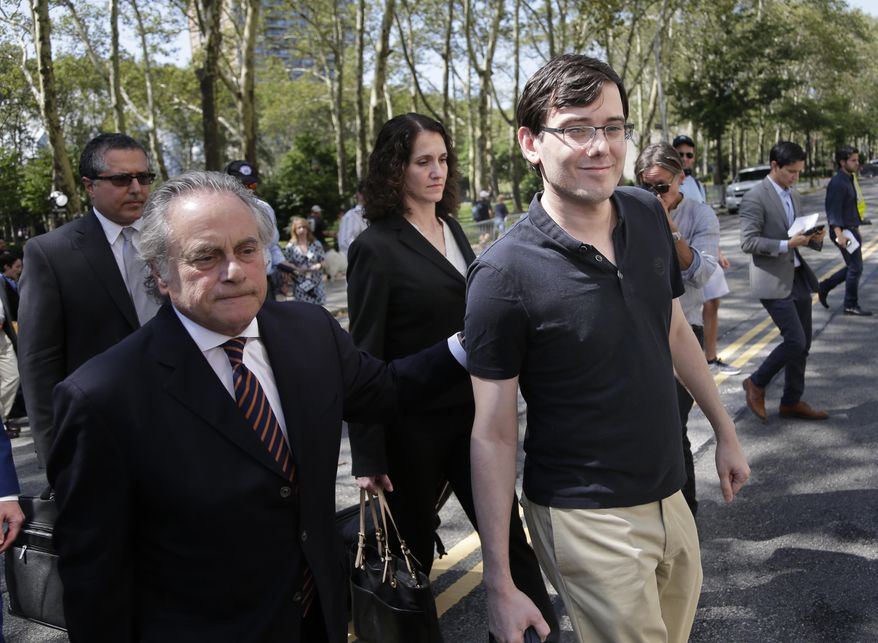 Martin Shkreli, right, and his attorney Benjamin Brafman, left, leave federal court in New York, Friday, Aug. 4, 2017. The former pharmaceutical CEO has been convicted on federal charges he deceived investors in a pair of failed hedge funds. A Brooklyn jury deliberated five days before finding Shkreli guilty on Friday on three of eight counts. (AP Photo/Seth Wenig)