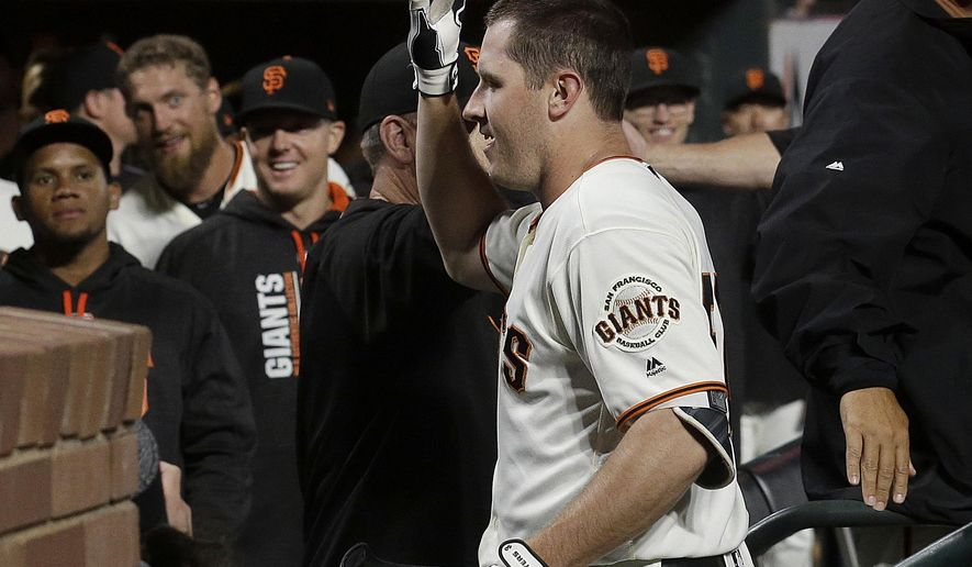 San Francisco Giants' Ty Blach is congratulated by teammates after hitting a three-run home run against the Oakland Athletics during the fifth inning of a baseball game in San Francisco, Thursday, Aug. 3, 2017. (AP Photo/Jeff Chiu)