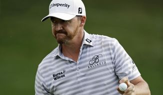 Jimmy Walker acknowledges the gallery after finishing the second round of the Bridgestone Invitational golf tournament at Firestone Country Club, Friday, Aug. 4, 2017, in Akron, Ohio. (AP Photo/Tony Dejak)