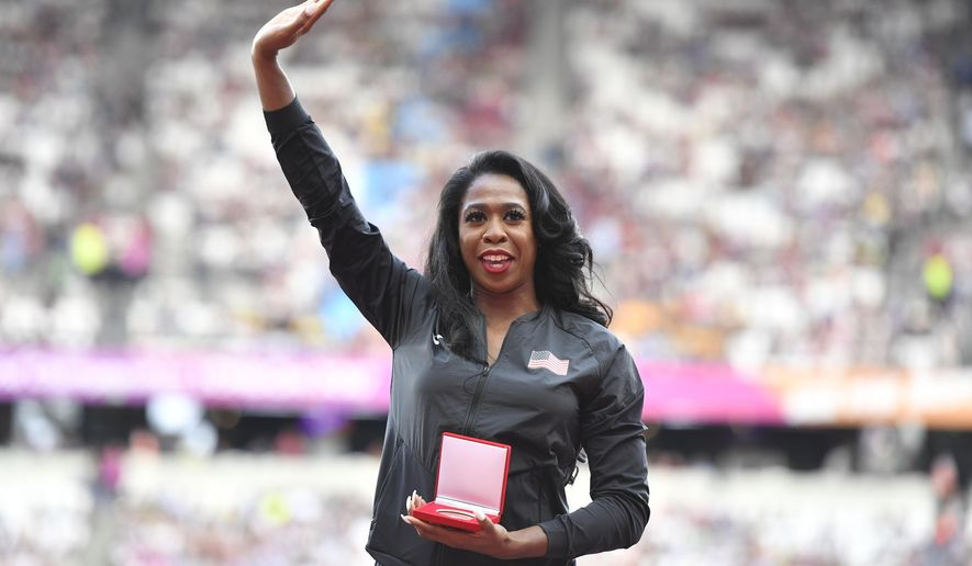 Francena McCorory of the United States waves to the crowd after she received her bronze medal during a ceremony at the World Athletics Championships in London, Friday, Aug. 4, 2017. McCorory originally finished fourth in the women's 400m at the World Championships in Daegu in 2011 but was promoted from fourth to bronze following the disqualification of the results of the original medallist after their sanction for anti-doping rule violations. (AP Photo/Martin Meissner)