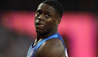United States' Christian Coleman reacts after completing a Men's 100 meters heat during the World Athletics Championships in London Friday, Aug. 4, 2017. (AP Photo/Tim Ireland)