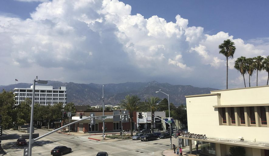 Thunderheads tower over the San Gabriel Mountains, northeast of Los Angeles on Thursday, Aug. 3, 2017. The National Weather Service says a very moist and unstable air mass hanging over Southern California is continuing to bring the threat of flash flooding to inland areas. (AP Photo/John Antczak)