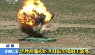 "In this image taken from a recent video footage run by China's CCTV on Friday, Aug 4, 2017, a target explodes during a live-fire drill by the Chinese army in China's Tibet Autonomous Region that border India. Beijing is intensifying its warnings to Indian troops to get out of a contested region high in the Himalayas where China, India and Bhutan meet, saying China has been restrained but ""restraint has its limits."" Chinese characters in yellow reads ""Artillery soldiers high altitude live fire drills"". (CCTV via AP)"