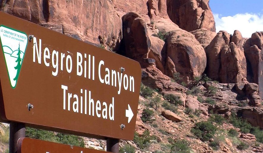 FILE - This undated file photo shows a sign at the entrance of the Negro Bill Canyon Trailhead in Moab, Utah. A Utah state commission is recommending preserving the name of Utah's Negro Bill Canyon despite concerns that it's offensive. (John Hollenhorst/The Deseret News via AP, File)