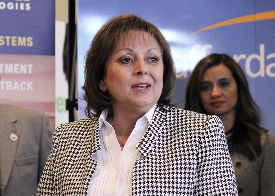 FILE - In this Feb. 1, 2017 file photo, New Mexico Gov. Susana Martinez, left, is back by New Mexico State Rep. Monica Youngblood as she speaks at a news conference in Albuquerque, N.M. Recent child killings, attacks on officers and a rise in crime has some conservative New Mexico lawmakers calling for the state to reinstate the death penalty. (AP Photo/Susan Montoya Bryan, File)
