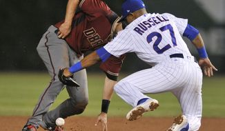 Chicago Cubs shortstop Addison Russell (27) drops the throw as Arizona Diamondbacks' A.J. Pollack steals second base during the sixth inning of a baseball game Wednesday, Aug. 2, 2017, in Chicago. Arizona won 3-0. (AP Photo/Paul Beaty)
