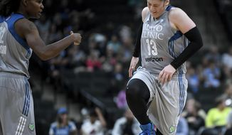 Minnesota Lynx guard Lindsay Whalen (13) winces in pain after injuring her left hand during the third quarter of the team's WNBA basketball game against the Atlanta Dream on Thursday, Aug. 3, 2017, in St. Paul, Minn. The Lynx won 69-54. (Aaron Lavinsky/Star Tribune via AP)