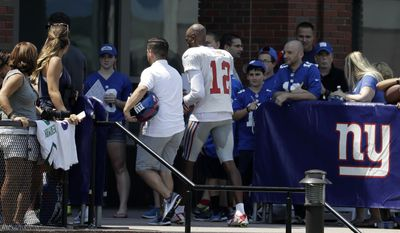 Spectators look on as New York Giants wide receiver Tavarres King (12) leaves the field early after limping off a play during NFL football training camp, Thursday, Aug. 3, 2017, in East Rutherford, N.J. (AP Photo/Julio Cortez)