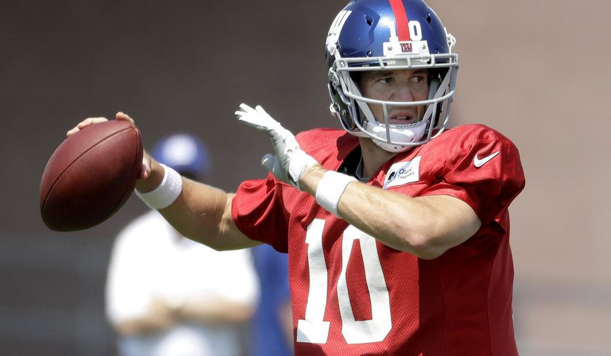 New York Giants quarterback Eli Manning throws a pass during NFL football training camp, Thursday, Aug. 3, 2017, in East Rutherford, N.J. (AP Photo/Julio Cortez)