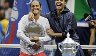 "FILE  - In this Saturday, Sept. 12, 2015 file photo Roberta Vinci, of Italy, left, and Flavia Pennetta, of Italy, react during the trophy ceremony for the women's championship match of the U.S. Open tennis tournament, in New York.  Former U.S. Open runner-up Roberta Vinci said her tennis trophies have been stolen, writing on Instagram, ""Unfortunately, a few days ago a group of thieves entered my house in Taranto and stole valuable objects. (AP Photo/David Goldman, File)"
