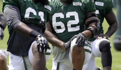 New York Jets defensive linemen Patrick Gamble, left, Devon Still, Anthony Johnson talk while stretching during NFL football training camp, Friday, Aug. 4, 2017, in Florham Park, N.J. (AP Photo/Julio Cortez)