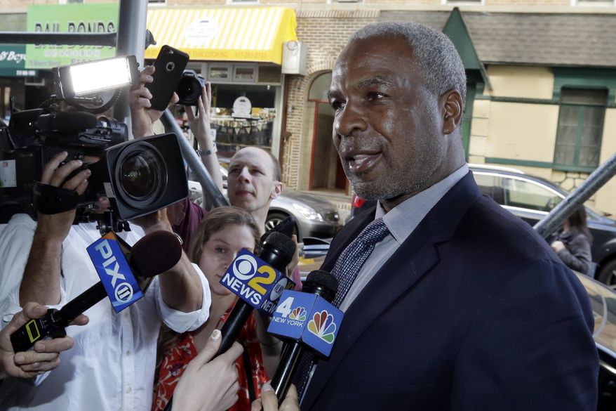 FILE - In this April 11, 2017, file photo, former New York Knicks star Charles Oakley talks to the press after an appearance in Manhattan Criminal Court, in New York. Oakley has reached a deal with prosecutors who charged him with striking a security guard at Madison Square Garden. The Daily News reports, Friday, Aug. 4, 2017, that charges against Oakley will be dismissed and sealed after six months of good behavior. (AP Photo/Richard Drew, File)