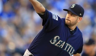 Seattle Mariners starting pitcher James Paxton delivers to a Kansas City Royals batter during the first inning of a baseball game at Kauffman Stadium in Kansas City, Mo., Friday, Aug. 4, 2017. (AP Photo/Orlin Wagner)