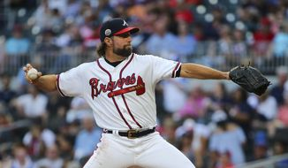 Atlanta Braves starting pitcher R.A. Dickey works against the Miami Marlins during the first inning of a baseball game Friday, Aug. 4, 2017, in Atlanta. (AP Photo/John Bazemore)