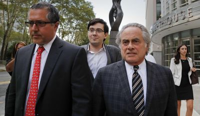 Former pharmaceutical company CEO Martin Shkreli, center, walks out of federal court with members of his legal team, Thursday, Aug. 3, 2017, in New York. Jurors were on their fourth day of deliberations on Thursday at the securities fraud trial of the former pharmaceutical company CEO. (AP Photo/Julie Jacobson)