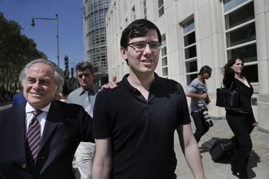 "Martin Shkreli, center, leaves federal court in New York, Friday, Aug. 4, 2017. Shkreli, the eccentric former pharmaceutical CEO notorious for a price-gouging scandal and for his snide ""Pharma Bro"" persona on social media, was convicted Friday on federal charges he deceived investors in a pair of failed hedge funds.  (AP Photo/Seth Wenig)"