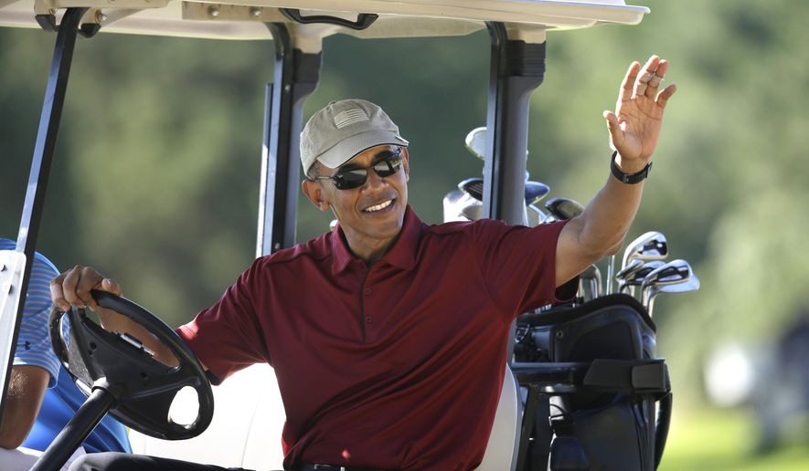 In this Aug. 14, 2015 photo, President Barack Obama waves from a golf cart while golfing at Farm Neck Golf Club, in Oak Bluffs, Mass., during vacation on the island of Martha's Vineyard. The Obamas are taking their annual vacation on Martha's Vineyard as private citizens in August 2017, just weeks before eldest daughter Malia, is slated to start at Harvard. (AP Photo/Steven Senne, File)