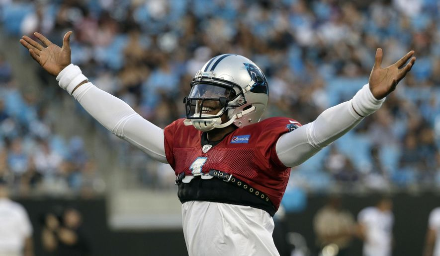 Carolina Panthers' Cam Newton (1) plays to the crowd during practice at the NFL football team's Fan Fest in Charlotte, N.C., Friday, Aug. 4, 2017. (AP Photo/Chuck Burton)