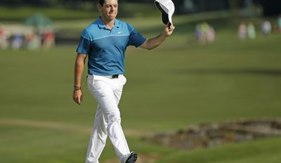 FILE - In this May 17, 2015, file photo, Rory McIlroy, of Northern Ireland, tips his cap to the crowd as he walks up to the 18th green before winning the Wells Fargo Championship golf tournament at Quail Hollow Club in Charlotte, N.C. McIlroy hasn't won all year, and he split with his caddie after the British Open. In a year without a victory, how would he measure his season if he were to win the PGA Championship?  (AP Photo/Chuck Burton, File)