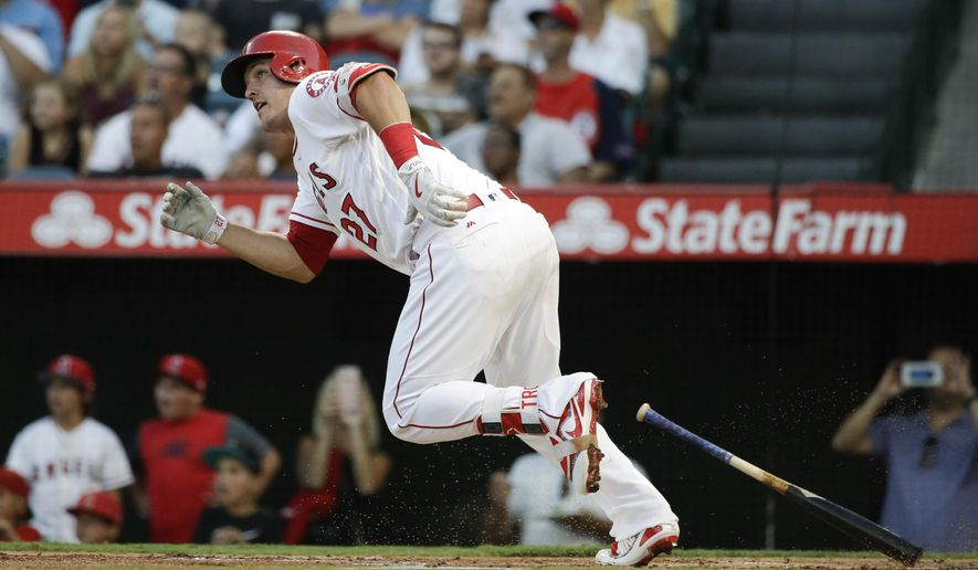 Los Angeles Angels' Mike Trout watches his two-run home run during the first inning of the team's baseball game against the Philadelphia Phillies, Thursday, Aug. 3, 2017, in Anaheim, Calif. (AP Photo/Jae C. Hong)